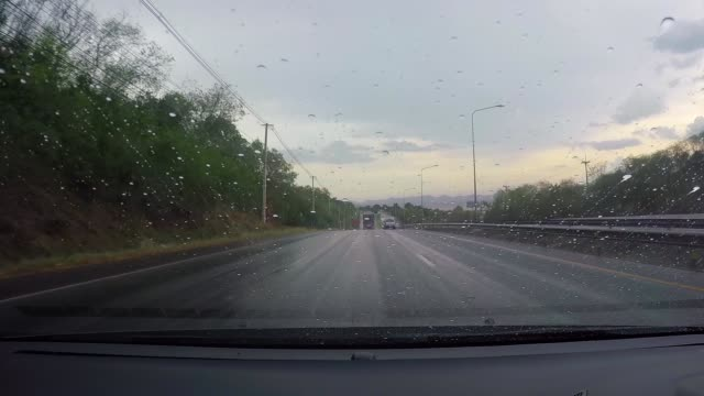 The view from the driver through the glass. While it is raining, the trip is dangerous and unclear. video