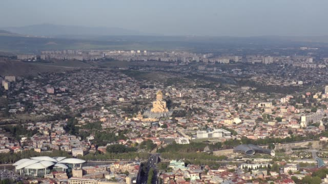 The view from the height of Tbilisi on Mtatsminda Park, Trinity Sameba Cathedral in center of frame