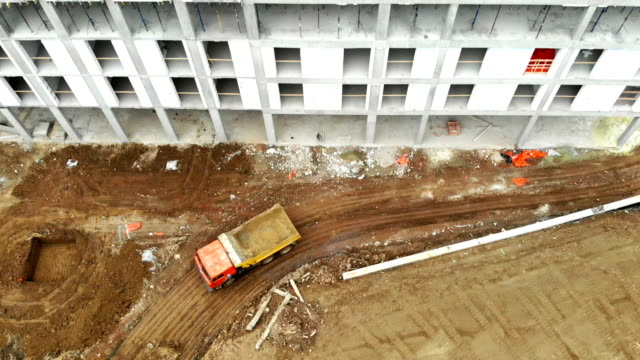 The view from the top. An empty truck drives past unfinished construction.