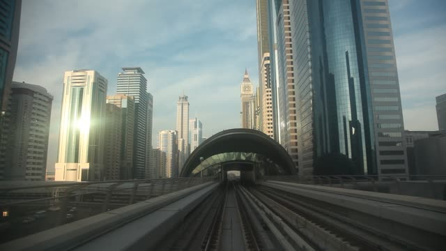 The view of the city from a moving metro car. Dubai, United Arab Emirates.