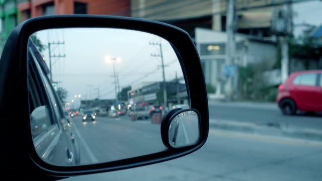 The view on side mirror, Blurred of traffic in side mirror video