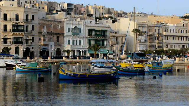 The view on traditional Maltese boats in sunset, Kalkara, Malta The view on traditional Maltese boats in sunset, Kalkara, Malta malta stock videos & royalty-free footage