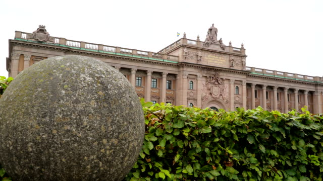 The view outside the riksdag building in Stockholm Sweden The view outside the riksdag building in Stockholm Sweden with the big statues on the top of the national legislature building royalty stock videos & royalty-free footage