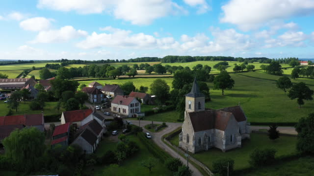 The village of Cuncy-les-Varzy in the middle of the countryside and St. Martin's Church at its entrance