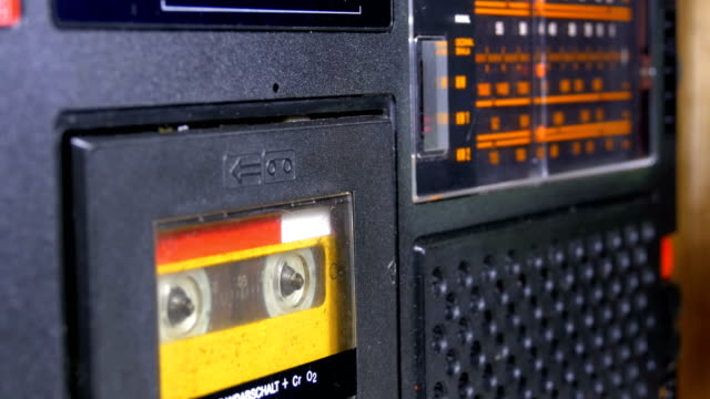 The Vintage Yellow Audio Cassette in the Old Tape Recorder Rotates video
