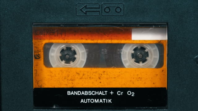 The Vintage Yellow Audio Cassette in the Tape Recorder Rotates