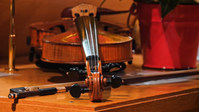 The violin on the table, Close up of violin on the wooden floor, The violin on the table, Close up of violin on the wooden floor, classical concert stock videos & royalty-free footage