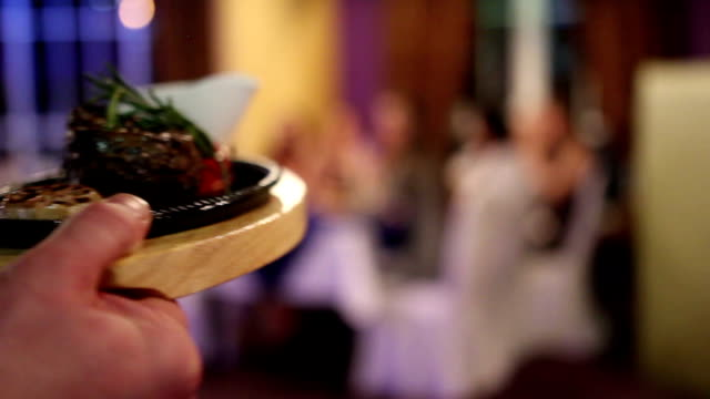 The waiter deliver plates with dishes video