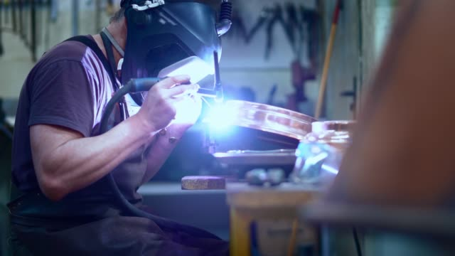 The welder working on the brass details with the electrical welding The welder working on the brass details with the electrical welding. 4K UHD video footage. copper stock videos & royalty-free footage