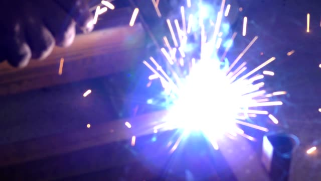 The welding and sparkles flying around with lights