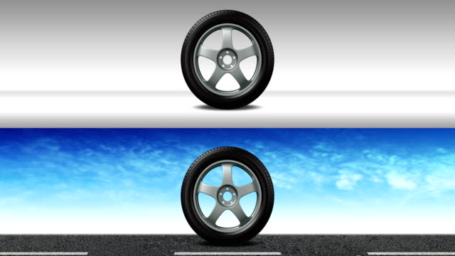 vídeos de stock e filmes b-roll de the wheel with new tires is rolling from left to right - alpha-matte - fundo oficina