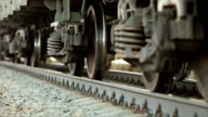 istock The wheels of old train on the railway track passing by camera. Close up shot. 1149107171