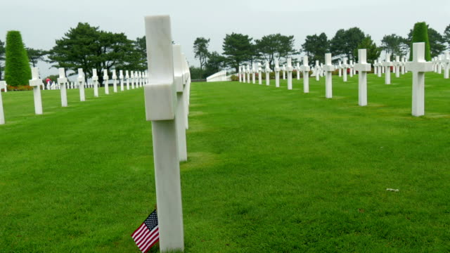 The white crosses on the cemetery The white crosses on the cemetery in France the Normandy American cemetery normandy stock videos & royalty-free footage