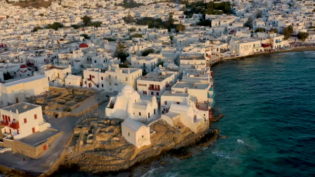 The white washed houses and church of Paraportiani at the old town of Mykonos island, Greece The white washed houses and church of Paraportiani at the old town of Mykonos island, Greece, during summer sunset time greek islands stock videos & royalty-free footage