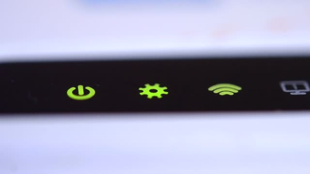the wifi icon flashes green on the router - wireless technology stock videos & royalty-free footage