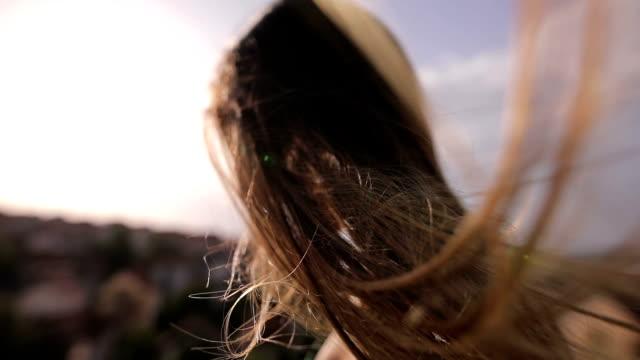 stockvideo's en b-roll-footage met de wind in het haar - hair woman