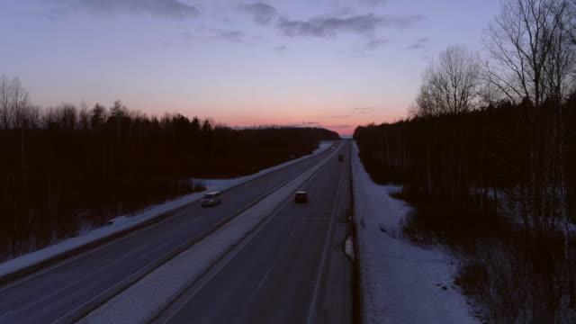 The winter sunset over the highway.