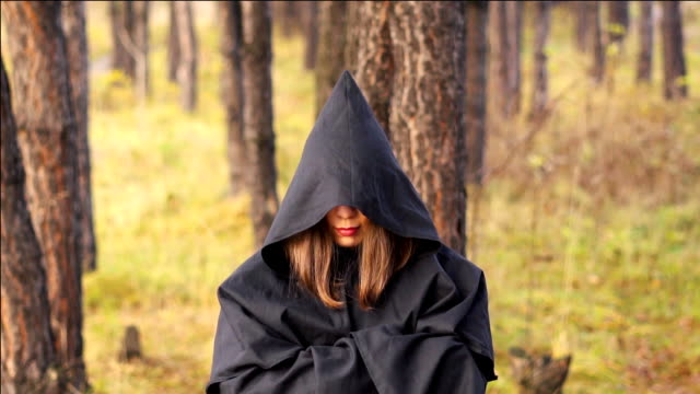 the witch in cloak in the woods video