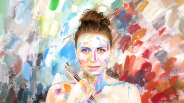the woman artist paints a picture. / - painter stock videos and b-roll footage