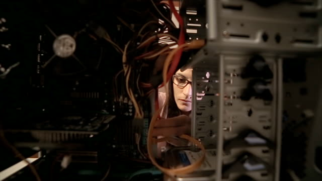 The woman fixes the computer video