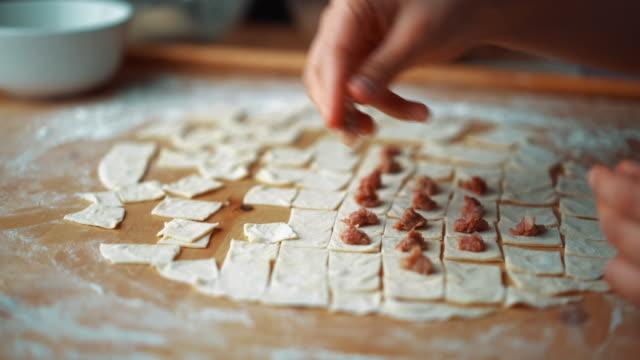 The Woman Preparing Turkish Traditional Food Mantı (Turkish Ravioli) Manti (Mantı) is Turkish traditional food like Italian ravioli, especially Kayseri Mantısı. ravioli stock videos & royalty-free footage