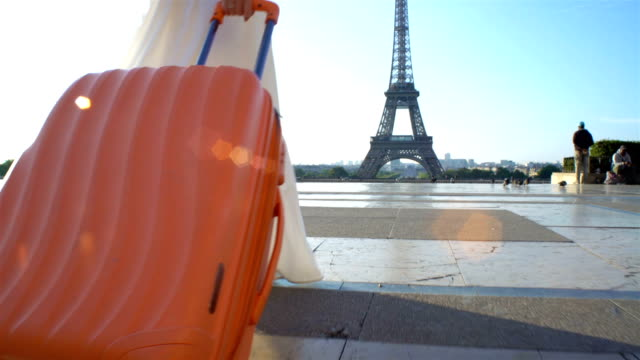 the woman with the orange suitcase traveling to paris - paris fashion stock videos and b-roll footage