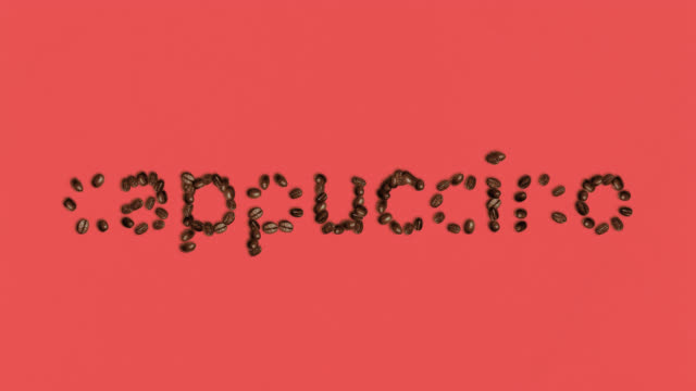 the word cappuccino Shaped coffee bean on red Background
