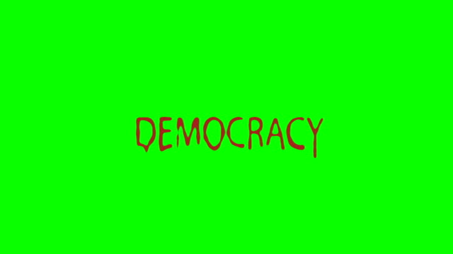 The Word Democracy Bleeding on a Green Screen
