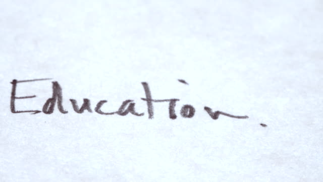 The word 'Education' written down on plain paper video