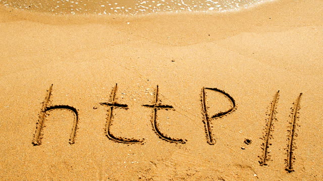 The word http handwritten in sand on a beach video