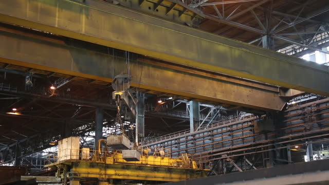 the work of the bridge magnetic crane. - metallurgia video stock e b–roll