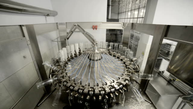 The working mechanism of the machine for washing glass bottles. View from above