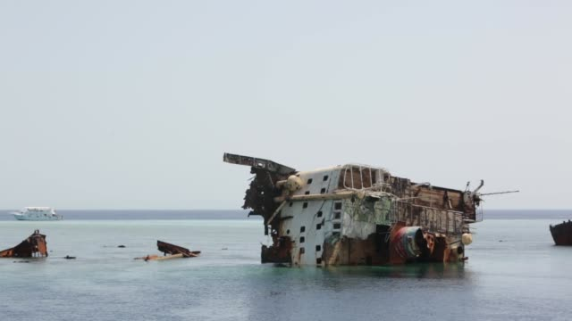 The wreckage of the ship sticks out of the water. Diving on a wreck