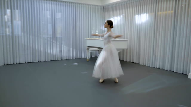 The young ballerina trains to do fouette on her left leg in the bright class video