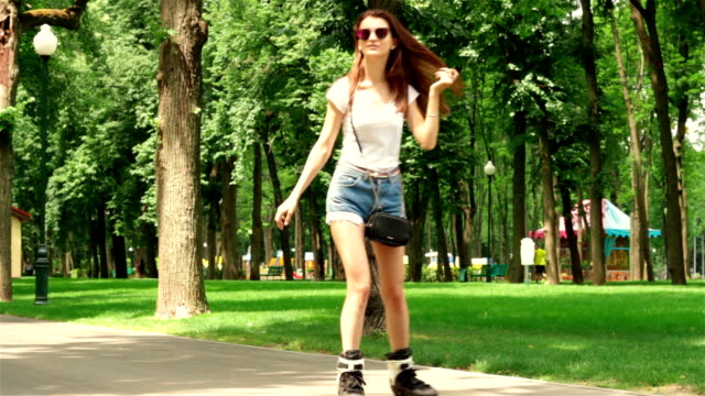 the young women quickly goes rollerblading the young women quickly goes rollerblading in the Park charming stock videos & royalty-free footage