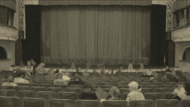 Theatre is filled with spectators (timelapse) video