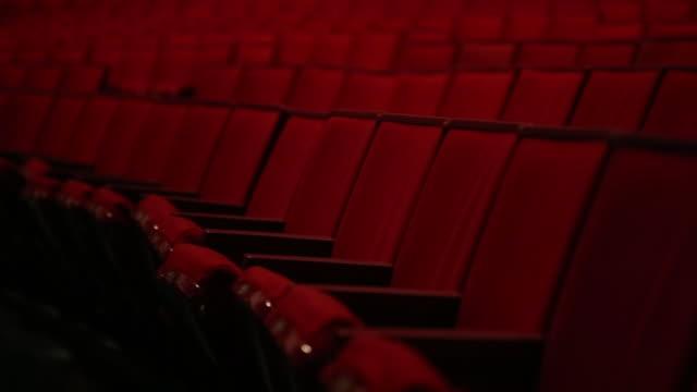 Theatre Red Seats Tracking Medium Shot Rack Focus