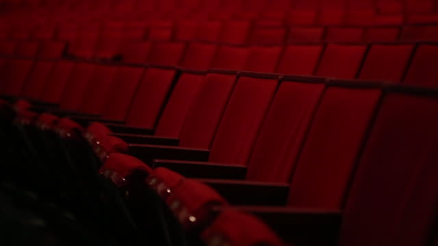 Theatre Red Seats Tracking Medium Shot Rack Focus Theatre Red Seats Tracking Medium Shot Rack Focus stage theater stock videos & royalty-free footage