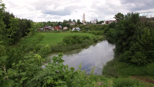 There is a church high above the river.