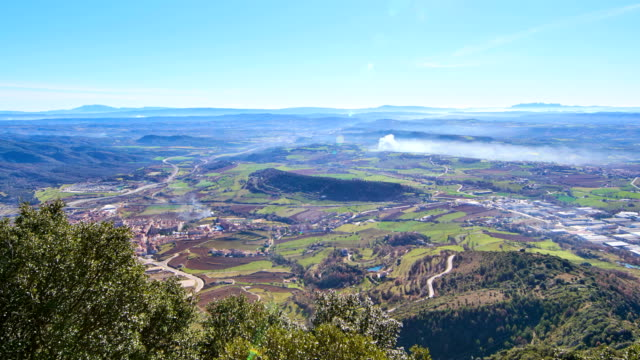 Thermal inversion time lapse video Views from Berga, in Catalonia, winter landscape with Montserrat mountain in the horizon. Thermal inversion, cold air remain in the earth surface and clouds doesn't ascen in the air column.  lleida stock videos & royalty-free footage