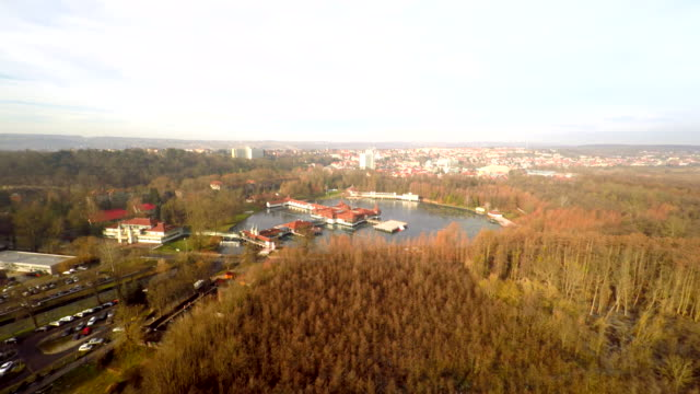 AERIAL Thermal lake and the Heviz in Hungary Aerial shot of the second largest thermal lake in the world with the city Heviz in the background. Keszthely. Hungary. hungary stock videos & royalty-free footage