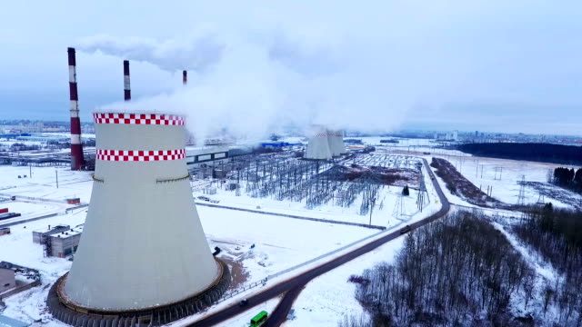 thermal plant aerial view. industrial factory chimney. industrial smoke - centrale termoelettrica video stock e b–roll