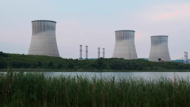 thermal power plant chimneys - centrale termoelettrica video stock e b–roll