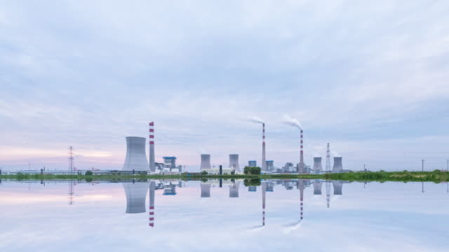 thermal power plant reflcetion in water  at night ,timelapse,4k video