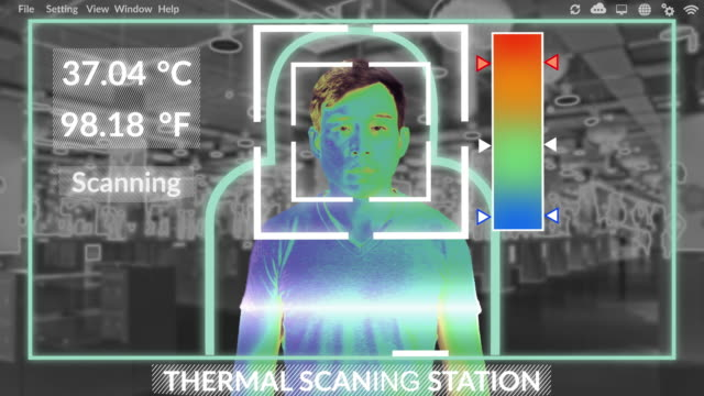 Thermal scanning system using AI is verifying a temperature of asian man at shopping mall to prevention of Novel Coronavirus nCoV ( COVIC-19) pandemic