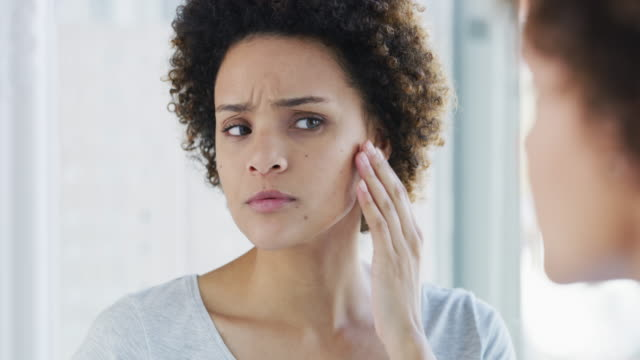 these pimple just won't go away - woman mirror video stock e b–roll