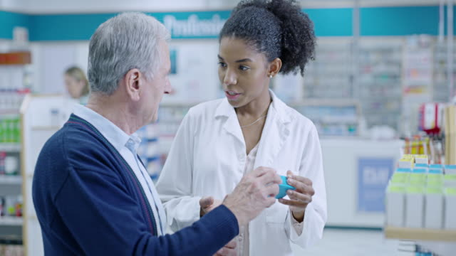 These will help you feel better in no time 4k video footage of a young pharmacist helping a senior man in a pharmacy pharmacy stock videos & royalty-free footage