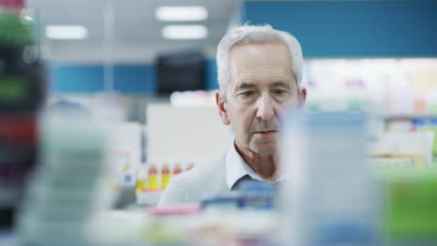 They have a variety to choose from 4k footage of a customer looking for medication in a pharmacy choosing stock videos & royalty-free footage