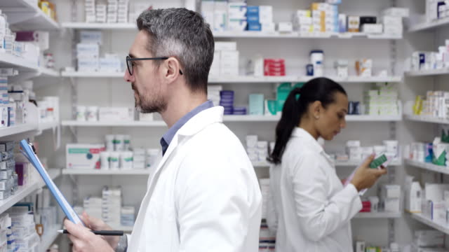 They have this pharmacy running like clockwork 4k video footage of two pharmacists checking stock together in a chemist pharmacist stock videos & royalty-free footage