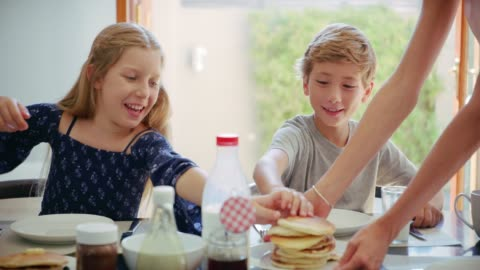 They love their pancakes 4k video footage of two young kids having breakfast at home with their family breakfast stock videos & royalty-free footage